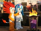 Mascots of the Singapore 2010 Youth Olympic Games attend the flame passing ceremony at the city celebration site in Dakar, Senegal.