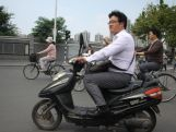 Motorcycles are the main source of transportation in Nanjing and safety is not a concern with most drivers not wearing helmets.