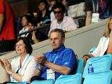 IOC President Jacques Rogge appears to watch the girls' and boys' singles final matches of badminton