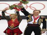 Tatiana Navka and Roman Kostomarov of Russia receive their gold medal after the Free Dance program of the figure skating.