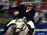 Hinrich Romeike of Germany on Marius celebrates victory and the gold medal in the Individual Eventing event at the Hong Kong Olympic Equestrian Venue in Sha Tin during Day 4 of the Beijing 2008 Olympic Games on August 12, 2008 in Hong Kong, China.