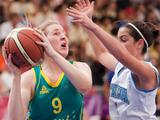 Italy 's Francesca Dotto (right) tries to defend against Australia 's Olivia Bontempelli during the girls' basketball match between Italy and Australia. Australia won 29-15.