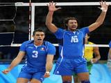 Valerio Vermiglio #3 and Vigor Bovolenta #16 of Italy react while taking on Brazil during the semifinal volleyball game.