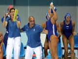 The Italian bench celebrates defeating Russia 9-8 during their preliminary water polo match at the Ying Tung Natatorium.