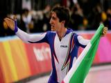 Enrico Fabris of Italy celebrates winning the Gold Medal in the men's 1500m speed skating final.