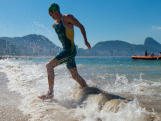 Jacob Birtwhistle of Australia leaves the water during the men's triathlon ITU World Olympic Qualification Event at Copacabana beach on August 2, 2015 in Rio de Janeiro, Brazil.