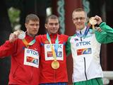 Sergey Bakulin (C) of Russia with his gold medal alongside silver medalist Denis Nizhegorodov (L) of Russia and bronze medalist Jared Tallent (R) in the Men's 50 Kilometres Race Walk Final at the 13th IAAF World Athletics Championships at Daegu Stadium.