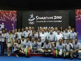 Officials and judges pose for photo after the closing of the weightlifting finals