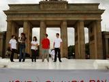 Teachers and students are interviewed under the Brandenburg Gate on Youth Olympic Day.