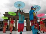 Culture performers from Singapore Showcase sing and dance during the flame welcoming ceremony in Berlin.