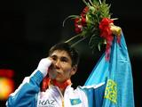 Bakhyt Sarsekbayev of Kazakhstan celebrates with the gold medal after defeating Carlos Banteaux Suarez of Cuba during the Men's Welter (69kg) Final Bout held at the Workers' Indoor Arena during Day 16 of the Beijing 2008 Olympic Games on August 24, 2008 in Beijing, China.
