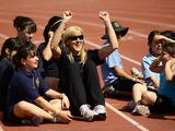 Sydney 2000 Olympic Games gold medallist Kerrie Potharst joins in with children participating in sports activities with Olympians and Paralympians as part of celebrations marking the 10th anniversary of the Sydney 2000 Olympics