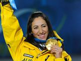 Lydia Lassila celebrates her gold medal at the official medal ceremony for the 2010 Vancouver Winter Olympic Games.