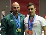 Weightlifting medallists Malek Chamoun and Liam Larkins at the 2015 Pacific Games.