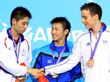 Silver medalist HUNG Tzu-Hsiang (L) of Chinese Taipei and bronze medalist Simon Gauzy (R) of France shake hands during the awarding ceremony of the men's singles