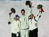 (L-R) Silver Medal winner Mikko Ronkainen of Finland, Gold Medal winner Dale Begg-Smith Australia and Bronze Medal winner Toby Dawson of the United States celebrate after the Mens Freestyle Skiing Moguls Final.