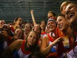 The Netherlands women's water polo team celebrate as they win the gold medal water polo match against the United States.