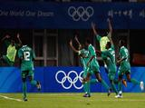 Nigerian players celebrate their win over Ivory Coast after the Men's Quarter Final match between Nigeria and Ivory Coast at Qinhuangdao Olympic Sports Center Stadium.