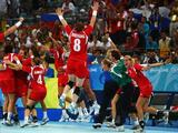 Norway players celebrate winning the gold medal following the Women's Handball Gold Medal Match between Norway and Russia.