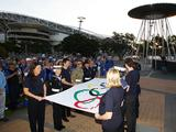 The Olympic Flag is displayed by military personnel during the Official Proceedings in the newly named Cathy Freeman Park