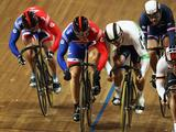 Sir Chris Hoy of Great Britain battles with Scott Sunderland of Australia in the second round of the Men's Keirin during the UCI Track World Championship at the Omnisport arena in Apeldoorn, Netherlands.