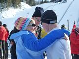 Alex Gibson gets a hug from mum at the end of his first race at the inaugural Winter YOG.