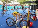 Ellie Salthouse transitions from the bike leg to the run in the women's individual triathlon at the Singapore Youth Olympic Games.