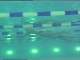 Peter Evans competes in the 100m Breaststroke