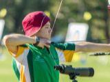 Youth Olympian archer Nicholas Turner taking a shot at target.