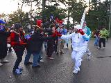 Toby Fender touches his mother's hand as carries the Olympic Torch during the Olympic Torch relay on October 31, 2009 in Colwood, British Columbia, Canada. The Olympic Flame will be travelling across Canada on the longest torch relay within a single country in Olympic history with nearly 200 communities across Canada and 12,000 torchbearers participating.