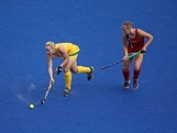Megan Rivers of Australia competes with Katelyn Falgowski of the United States during the Women's Hockey preliminary match between Australia and United States on Day 6.