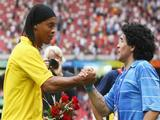 Diego Maradona of Argentina shakes the hand of Ronaldinho of Brazil during the medal ceremony for the Men's Football at the National Stadium on Day 15 of the Beijing 2008 Olympic Games on August 23, 2008 in Beijing, China.