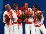 The Russian team with Svetlana Boyko, Evgenia Lamonova, Victoria Nikichina and Aida Shanaeva pose with the gold medal after the Fencing Women's Team Foil.