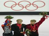 (L-R) Stephane Lambiel of Switzerland wins the silver medal, Evgeni Plushenko of Russia wins the gold medal and Jeffrey Buttle of Canada wins the bronze medal in Men's Figure Skating following the Men's Free Skate Program Final during Day 6 of the Turin 2006 Winter Olympic Games on February 16, 2006 at the Palavela in Turin, Italy.