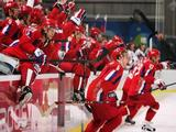 Team Russia celebrates defeating Canada 2-0 in their quarter final of the men's ice hockey match.