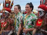 Australian rugby sevens players pose with Opening Ceremony performers at 2015 Pacific Games