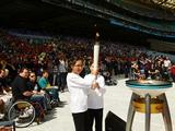 Newington Public School Captains Hannah Chiu and Anthony Melnyk light the Community Cauldron at the Schools Celebration as part of celebrations marking the 10th anniversary of the Sydney 2000 Olympics at Sydney Olympic Park
