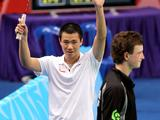 Huang Chao of Singapore celebrates winning over Richardson Asher of New Zealand. Huang Chao won the match 2-0.