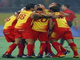 Spain celebrates winning 3-2 over Australia in the men's semifinal match held at the Olympic Green Hockey Field.