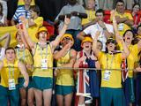 Australia's supporters rejoice on the spectator stands after the Australian team clinched the gold medal