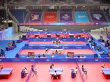 Players compete during the table tennis matches