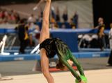 Youth Olympic gymnast Tara Wilkie working the floor with the ball apparatus.