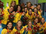 <p>The Australian women's water polo team pose with their bronze medals after defeating Hungary in the bronze medal water polo match held at the Yingdong Natatorium of National Olympic Sports Centre. </p>