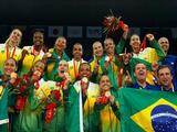 The Brazilian team celebrate on the podium with their gold medlas after winning the women's gold medal volleyball game against the United States.