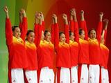 The China synchronized swim team receive their bronze medals during the medal ceremony for the free routine final at the National Aquatics Center.