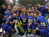Team Sweden poses for a team photo with their gold medals after defeating Finland 3-2 in the final of the men's ice hockey match between Finland and Sweden.