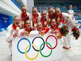 The Russia synchronized swim team poses for a photo with their gold medals following the medal ceremony for the free routine final at the National Aquatics Center.