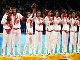 Russia players stand on the podium with their bronze medals after the Gold Medal volleyball match between the United States and Brazil held at the Capital Indoor Stadium.