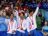 Sang Eun Oh, Seung Min Ryu and Jae Young Yoon of Korea celebrate their silver medal in the Men's Team Contest against China.