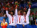 Park Mi Young, Dang Ye Seo and Kim Kyung Ah of South Korea celebrate after winning the bronze medal in the women's team table tennis event.